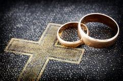 Marriage. Golden wedding ring on bible (macro photo Stock Photo