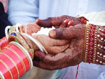 During Marriage in India men and women hand put in each other hand and promised to not breakup we in life and colorful royalty free stock photo