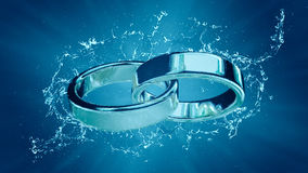 Marriage marriage marry ring rings wedding ring under water splash Stock Photo