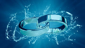 Marriage marriage marry ring rings wedding ring under water splash Royalty Free Stock Image