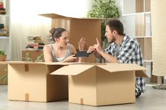 Marriage moving home fighting for a tablet stock photos