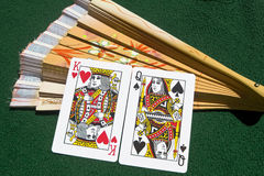Marriage of playing cards and a fan Stock Photos