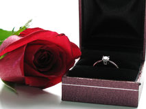 Marriage Proposal. A red rose and a diamond ring make a perfect giftset for a marriage proposal royalty free stock photo