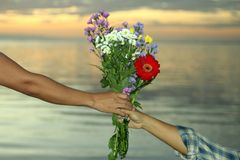 Marriage proposal with beautiful flowers bouquet. Romantic marriage proposal concept stock photo