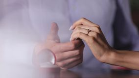 Marriage proposal. Closeup man wearing ring on woman`s hand. Marriage proposal. Closeup man wearing engagement ring on woman`s hand in restaurant stock footage