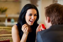 Marriage proposal, man give ring to his girl. Marriage proposal, men give ring to his girl, young happy couple romantic date at restaurant, celebrating valentine royalty free stock image