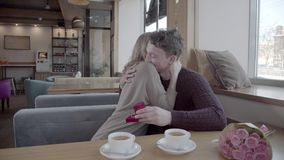 Marriage Proposal - A man gives a ring to a woman proposing marriag stock video footage