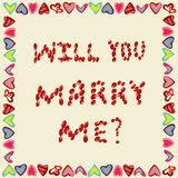 Marriage proposal from petals of roses on a yellow background, in the frame Stock Photos