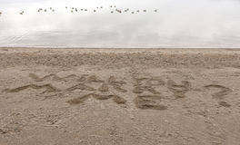 Marriage proposal in the sand. Royalty Free Stock Images