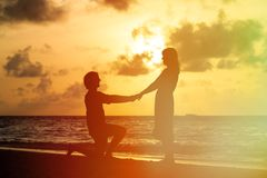 Marriage Proposal at sunset beach stock image