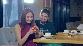 Marriage proposal on Valentine`s Day. Celebrating a Valentine`s Day at a restaurant. 4K stock footage