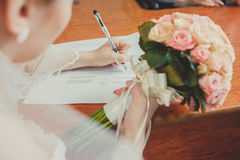 Marriage registration. Bride holding wedding bouquet. Stock Images