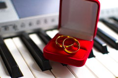 Marriage ring. Wedding ring over the piano keys Royalty Free Stock Image