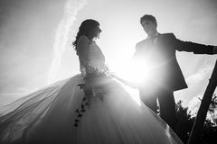 Marriage sea breeze. Marriage bridal dresses beach couple in love royalty free stock photography