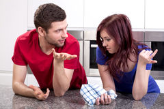 Marriage talking in kitchen Stock Photos