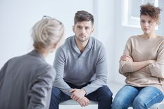 Marriage on a therapy. Young marriage in conflict in a therapy with psychologist Royalty Free Stock Image
