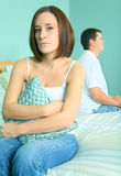 Marriage In Trouble. Caucasian young woman looking to viewer with sad expression over marriage trouble Stock Photos