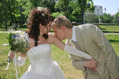 Married. Bridegroom kisses shoulder of the bride Royalty Free Stock Photography