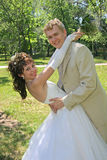 Married. Portrait of the bridegroom and brides on lawn in park Stock Photo