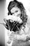 Married bride holding flowers and smelling them Stock Photography