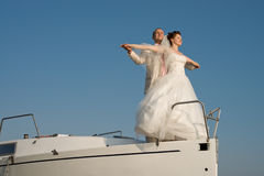 Married couple. Newly married couple stand on nose white yacht, on sky background Royalty Free Stock Image