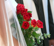 Married couple. With red roses Stock Images