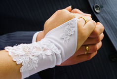 Married couple. Bride and groom are holding hands with rings Royalty Free Stock Photos