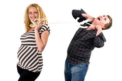 Married couple. A married couple where the woman has control over the man with a rope Stock Photo