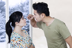 Married couple arguing at home Stock Image