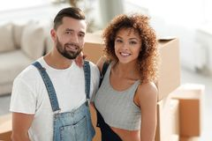 Happy married couple on the background of a new apartment Stock Image