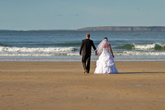 Married couple on the beach Royalty Free Stock Image