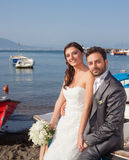 Married couple at the beach in Sorrento coast. Married couple in day of their wedding at the beach in Sorrento coast royalty free stock photography