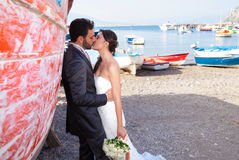 Married couple at the beach in Sorrento coast. Married couple in day of their wedding at the beach in Sorrento coast stock image
