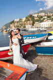 Married couple at the beach in Sorrento coast. Married couple in day of their wedding at the beach in Sorrento coast stock photography