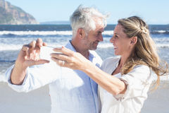 Married couple at the beach together taking a selfie. On a sunny day Stock Photos