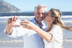 Married couple at the beach together taking a selfie Stock Photo