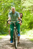 Married couple on a bike Stock Photo