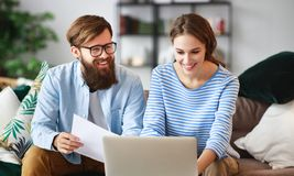 Married couple with bills receipts documents and laptop at home royalty free stock image