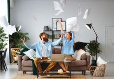 Married couple with bills receipts documents and laptop at home stock photo