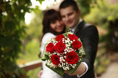 Married couple with a bouquet Stock Images