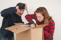 Married couple and box. Stock Image