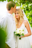 Married couple, bride and groom getting married, Tropical weddin Royalty Free Stock Image