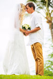Married couple, bride and groom getting married, Tropical weddin Stock Photos