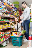 Married couple buying food Stock Images