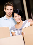 Married couple carrying cardboard boxes Royalty Free Stock Image