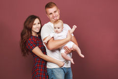 Married couple with a child Stock Images