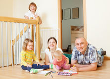 Married couple with children and  grandmother. In home interior together Royalty Free Stock Photography