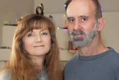 A Married Couple with Christmas Lights Behind Stock Photography