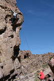 Married couple on climb. A husband belaying, and a wife halfway up a 70 foot climb in the Promised Land, Chino Valley, Arizona Stock Photos