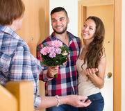Married couple come to elderly mother. At parent home Stock Images